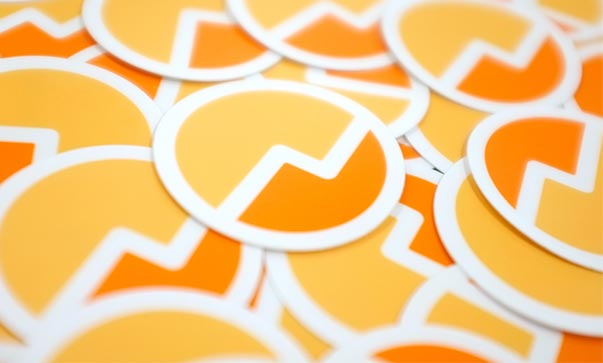 A pile of stickers sporting the Fundera logo